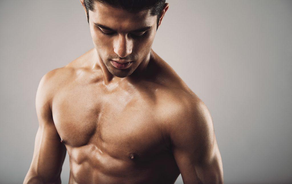 man posing showing muscles
