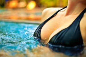 woman's chest in pool