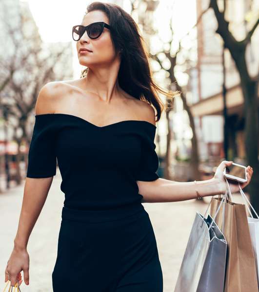 woman holding bags looking away