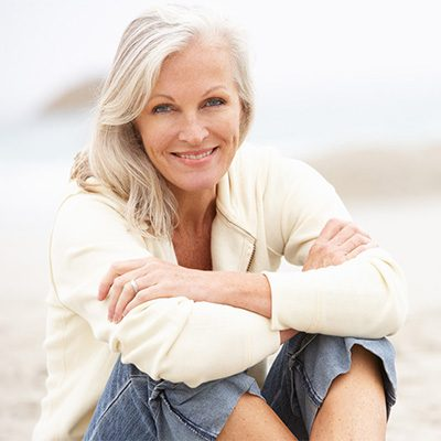 woman sitting on each smiling